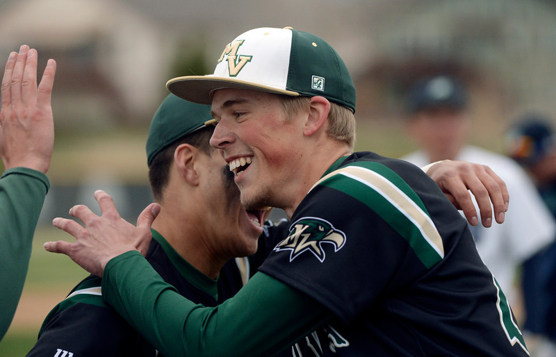 . Golden Eagles pitcher Nick Leonard celebrated with teammates after he threw a complete game shutout. The Mountain Vista High School baseball team blanked ThunderRidge 3-0 Wednesday afternoon, April 16, 2014. (Photo by Karl Gehring/The Denver Post)