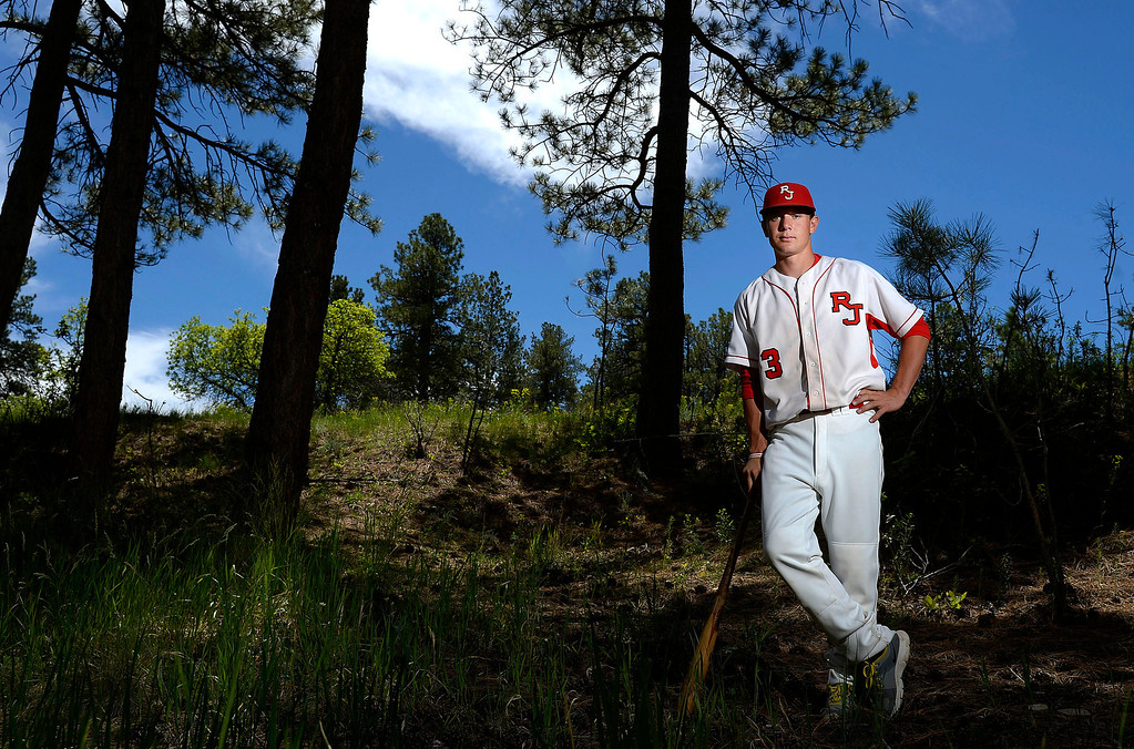 . Former Regis Jesuit player Max George is expected to be drafted in the MLB draft (June 5-7) after a successful high school career. George posed for a portrait at his home on Tuesday, June 3, 2014. (Photo by AAron Ontiveroz/The Denver Post)