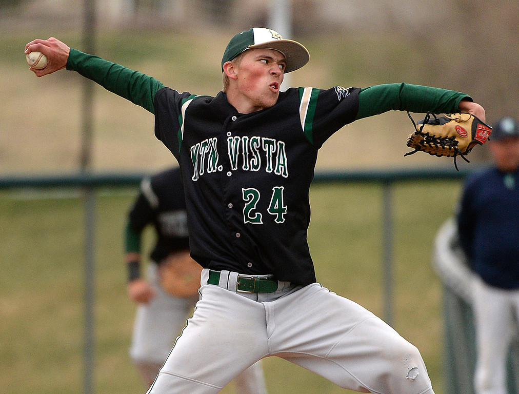 . Golden Eagles pitcher Nick Leonard delivers to the plate in the ninth inning. Leonard threw a complete game shutout. The Mountain Vista High School baseball team blanked ThunderRidge 3-0 Wednesday afternoon, April 16, 2014. (Photo by Karl Gehring/The Denver Post)