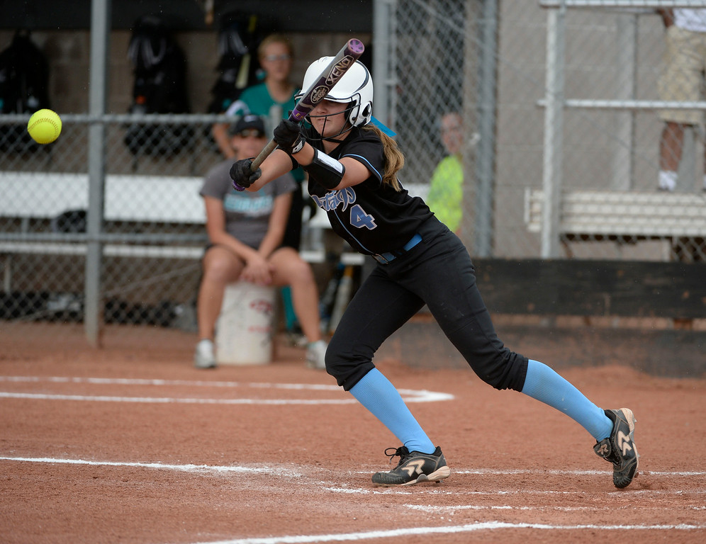 . Mountain Range outfielder, Ellery Sherman successfully bunts, reaches first base and advances a runner to second base in the second inning against Westminster High School during the championship game of the inaugural 2014 King of the Mountain 5A softball tournament at Mountain Range High School Saturday afternoon, August 30, 2014. (Photo By Andy Cross / The Denver Post)