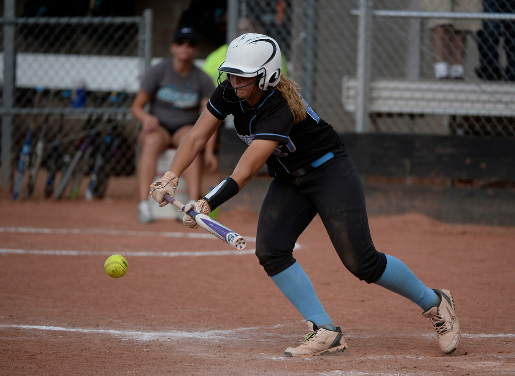 . Mountain Range High School softball player, Riley Craig lays down a bunt against Westminster High School in the 6th inning, scoring a runner during the championship game of the inaugural 2014 King of the Mountain 5A softball tournament at Mountain Range High School Saturday afternoon, August 30, 2014. Mountain Range won 15-2. (Photo By Andy Cross / The Denver Post)