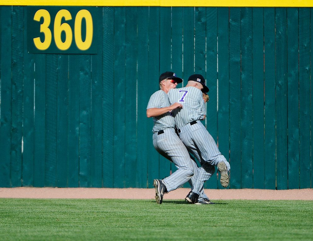 . DENVER, CO - MAY 25:  Kollin Evens, Mountain View, left, and teammate, Justin Dennis, collide after Evens made a nice catch for an out against a Pueblo West batter in the 7th inning of play during the 2013 4A Colorado State Championship game at All City Stadium. Mountain View went on to win in extra innings 7-6. (Photo By Andy Cross/The Denver Post)