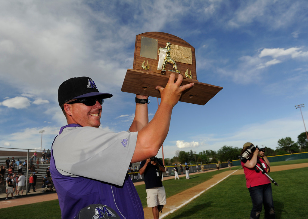 . DENVER, CO - MAY 25: Mountain View Mt. Lions baseball head coach, Brian Smela, hoists the 2013 4A Colorado State baseball championship trophy after defeating the Pueblo West Cyclones 7-6 in extra innings Saturday May 25, 2013 at All City Stadium.  (Photo By Andy Cross/The Denver Post)