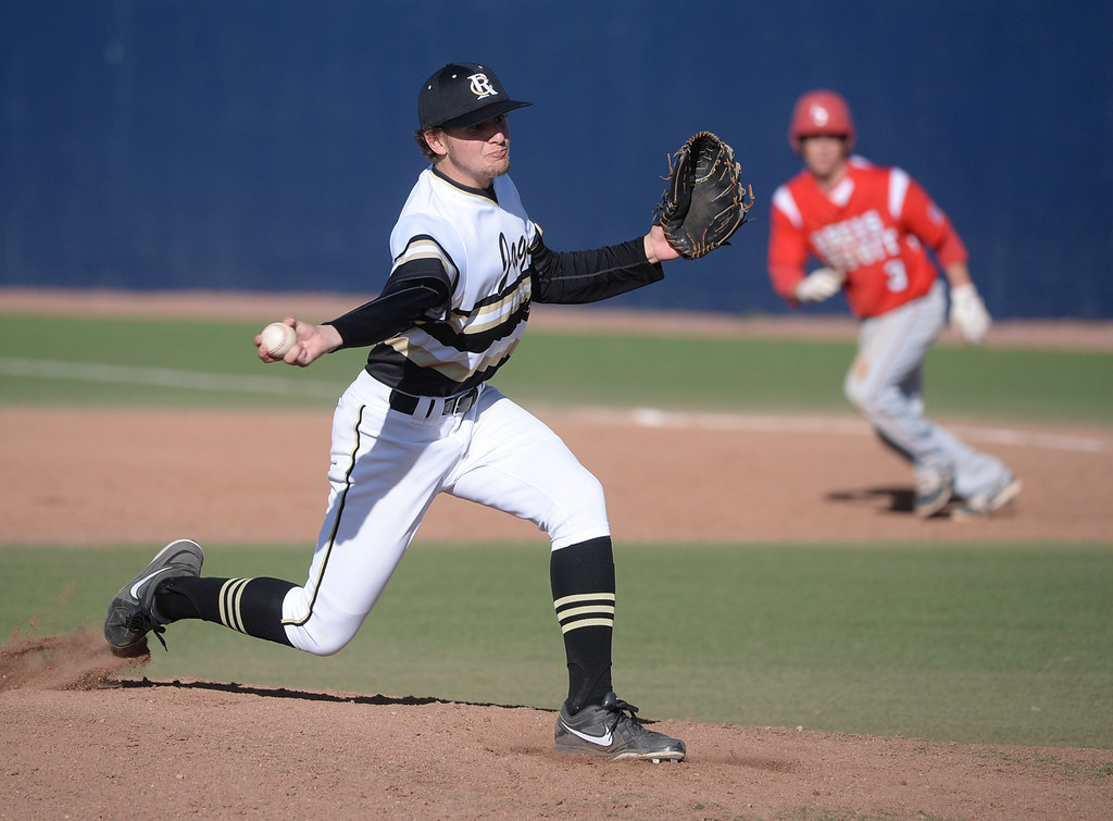 . Rock Canyon pitcher Christian Myers delivered to the plate with a runner on base. The Regis Jesuit baseball team defeated Rock Canyon 10-1 Friday afternoon, April 11, 2014.  (Photo by Karl Gehring/The Denver Post)