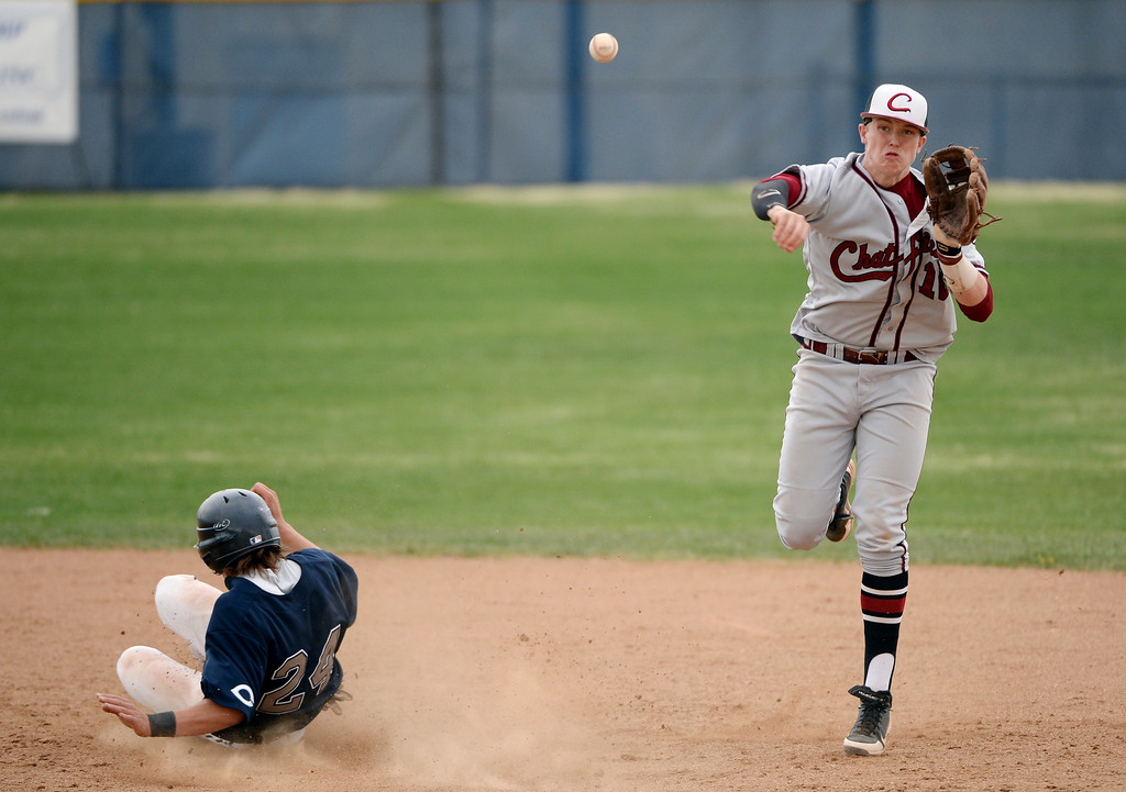 . Kyle Winkler of Chatfield High School (10), right, tags Columbine\'s Austin Anderson and throws the ball to first base for the double play during Wednesday\'s game. Third-ranked Columbine defeated No. 1 Chatfield, 12-6. (Photo by Hyoung Chang/The Denver Post)