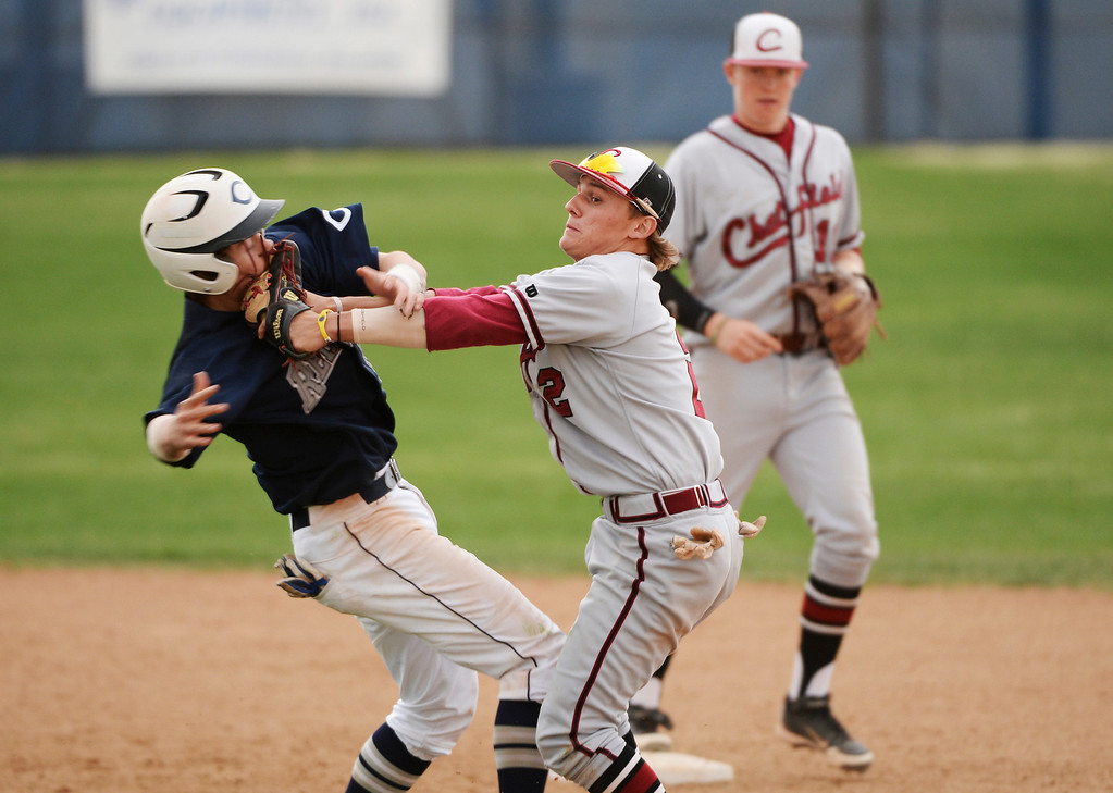 . Sean O\'Dell of Chatfield High School (2), front right, tags Tommy Gillman of Columbine High School (6) during the game at Columbine High School.  (Photo by Hyoung Chang/The Denver Post)