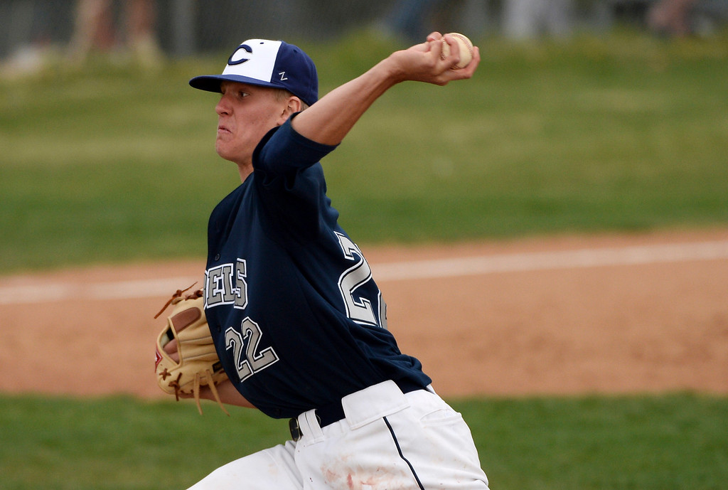 . Blake Weiman of Columbine High School (22) launches a pitch against Chatfield High School at Columbine High School. Littleton, Colorado.  (Photo by Hyoung Chang/The Denver Post)