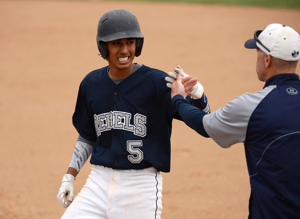 . Isaish Gonzalels-Montoya of Columbine High School (5) celebrates his single. (Photo by Hyoung Chang/The Denver Post)
