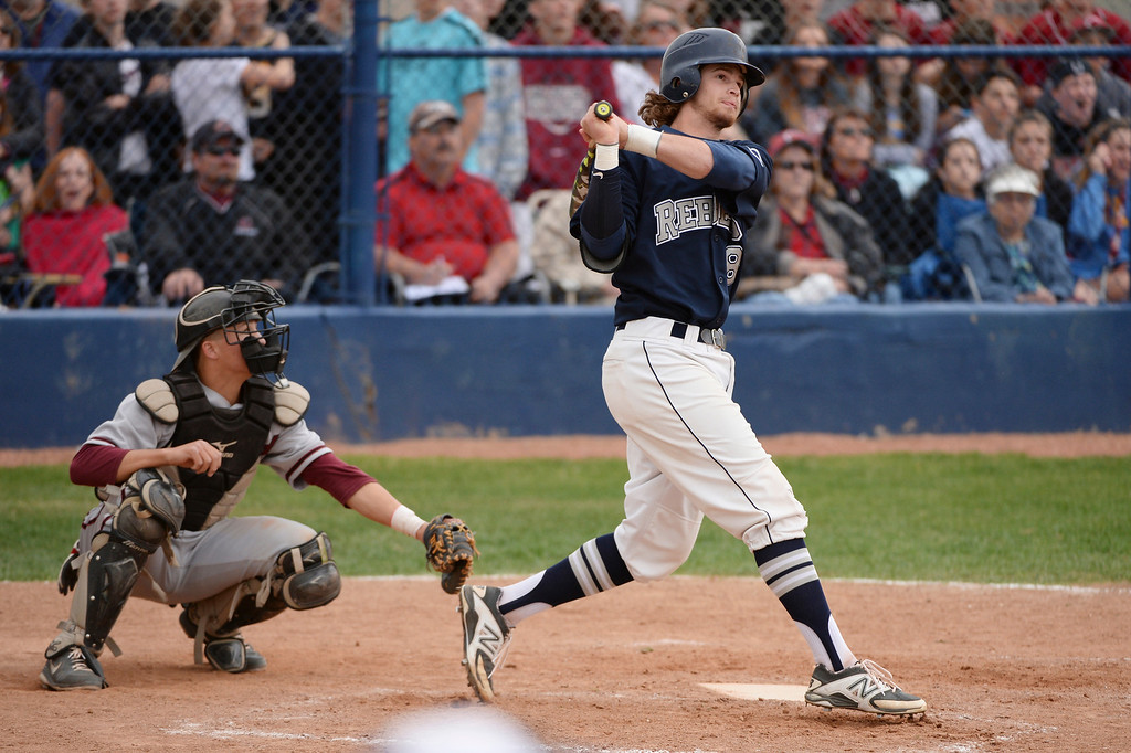 . Tyler Mohr of Columbine High School (8) watches his grand-slam home run during the game against Chatfield High School at Columbine High School.  Third-ranked Columbine defeated No. 1 Chatfield, 12-6. (Photo by Hyoung Chang/The Denver Post)
