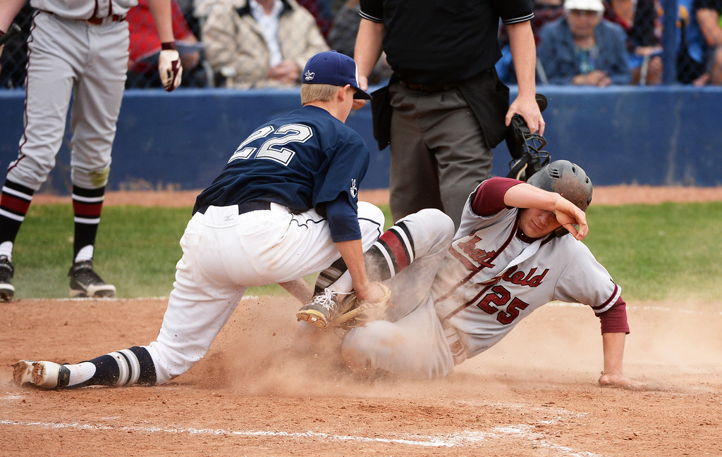 . Blake Weiman of Columbine High School (22) puts the tag on Patrick Barder of Chatfield High School (25) during the game at Columbine High School.  (Photo by Hyoung Chang/The Denver Post)
