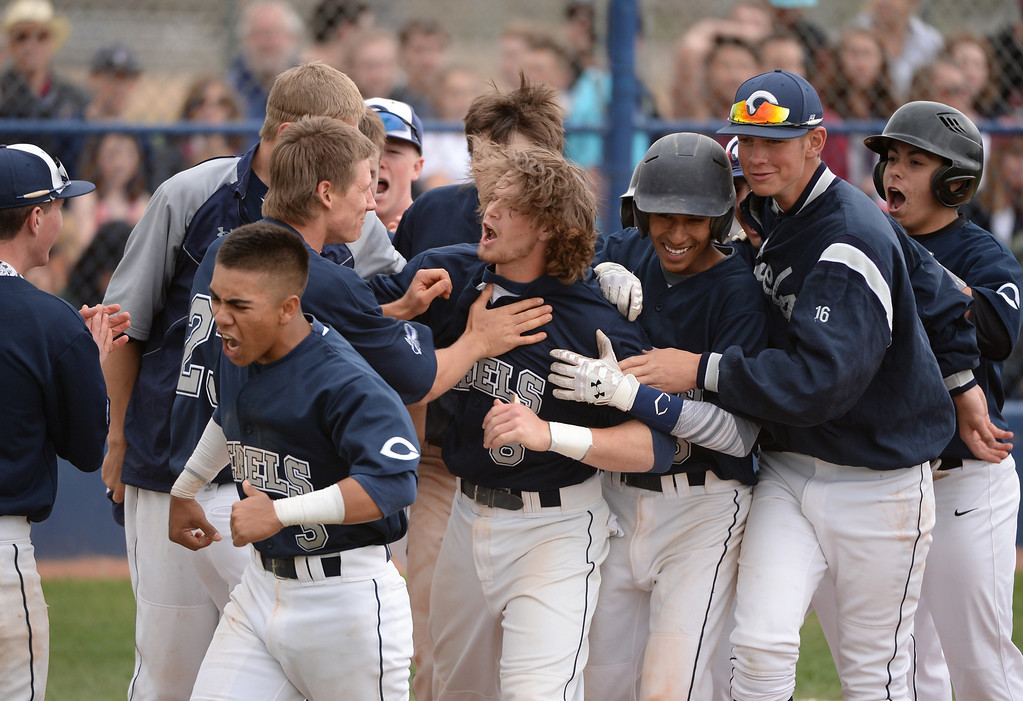 . Tyler Mohr of Columbine High School (8) celebrates his grand slam with the teammates during the game against Chatfield High School.  Third-ranked Columbine defeated No. 1 Chatfield, 12-6. (Photo by Hyoung Chang/The Denver Post)