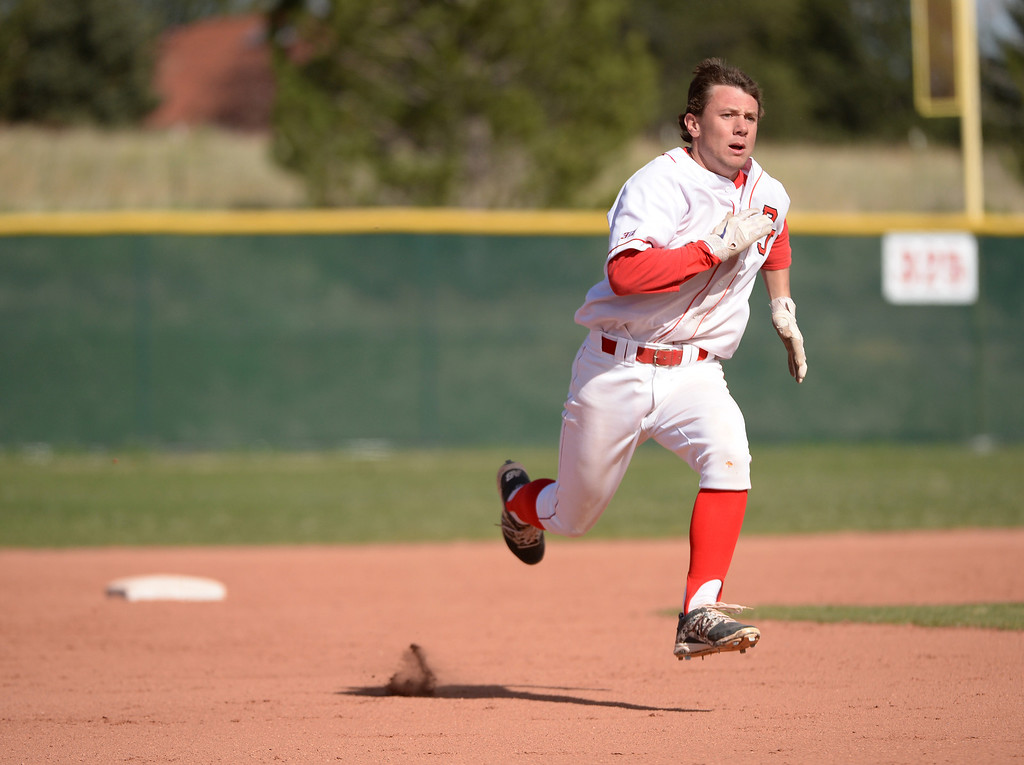 . Max George of Regis Jesuit High School (3) heads for third base in the first inning of the game against Mountain Vista High School. George tripled and scored 1RBI in the inning.   (Photo by Hyoung Chang/The Denver Post)