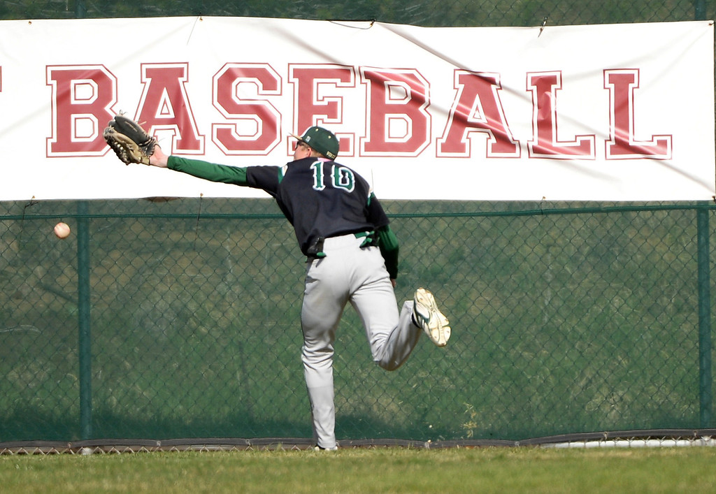 . Tyler Tullis of Mountain Vista High School (10) chases a ball hit by Max George of Regis Jesuit High School (3) in the first inning at Regis Jesuit High School.  George tripled and scored 1 RBI from the play.  (Photo by Hyoung Chang/The Denver Post)