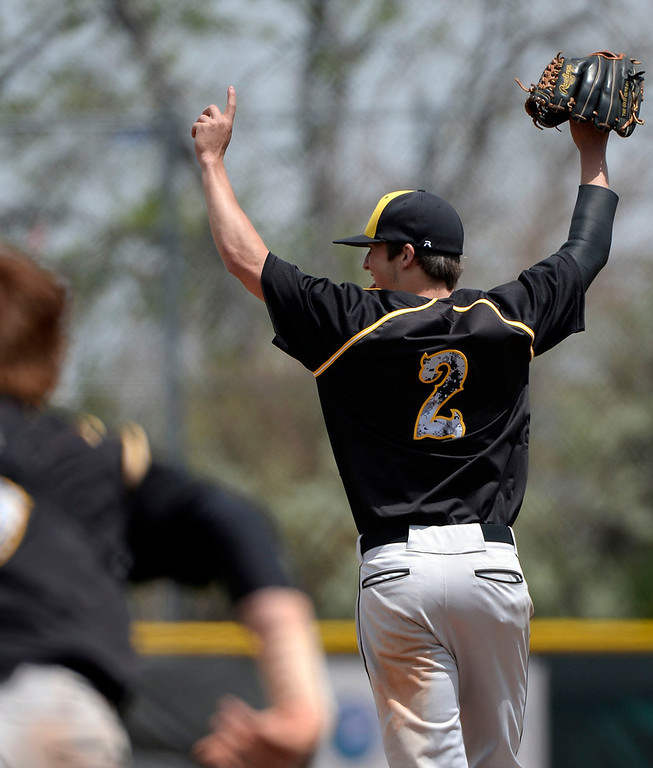 . Caliche pitcher Mitch Davison (2) celebrates their win over Dove Creek in the Championship game May 15, 2014 at All-Star Park. Caliche defeated Dove Creek 17-1 for the title.  (Photo by John Leyba/The Denver Post)