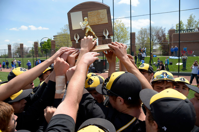 . Caliche players hold the state trophy up after their win over Dove Creek in the Championship game May 15, 2014 at All-Star Park. Caliche defeated Dove Creek 17-1 for the title.  (Photo by John Leyba/The Denver Post)