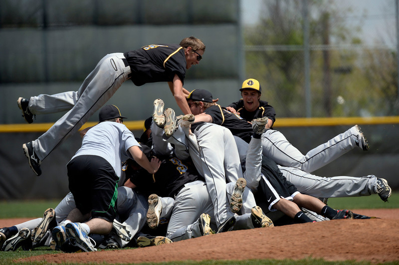 . Caliche Chase Debus (24) sails high to land on teammates after their win over Dove Creek in the Championship game May 15, 2014 at All-Star Park. Caliche defeated Dove Creek 17-1 for the title.  (Photo by John Leyba/The Denver Post)