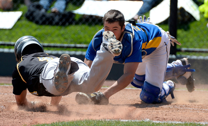 . Caliche Autin Zink (40 dives head firs attempting to score at home as Dove Creek Alex Ogas (30) tags him out in the Championship game May 15, 2014 at All-Star Park. Caliche defeated Dove Creek 17-1 for the title. (Photo by John Leyba/The Denver Post)
