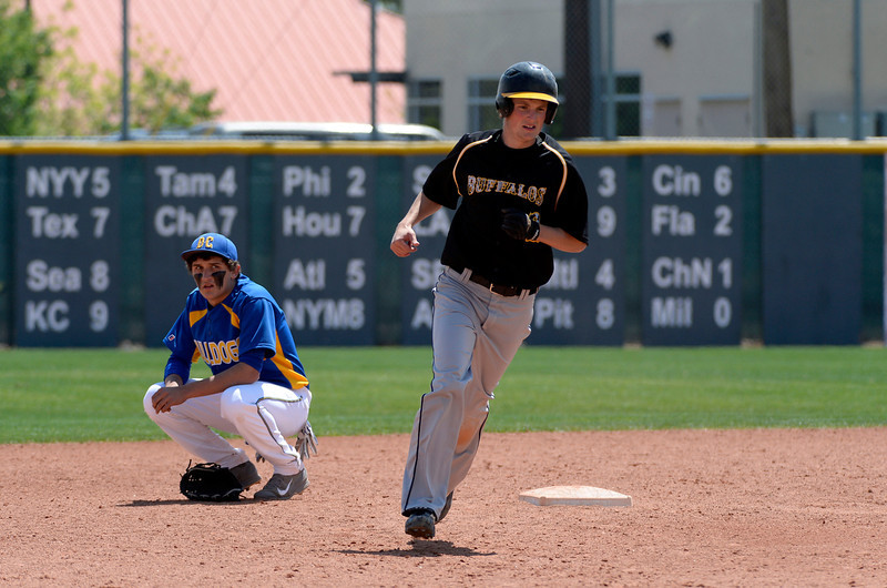 . Caliche Mitch Davison (2) round second base after his home run in the 4th inning as Dove Creek Jordan Ernst (8) looks on in the Championship game May 15, 2014 at All-Star Park. Caliche defeated Dove Creek 17-1 for the title. (Photo by John Leyba/The Denver Post)