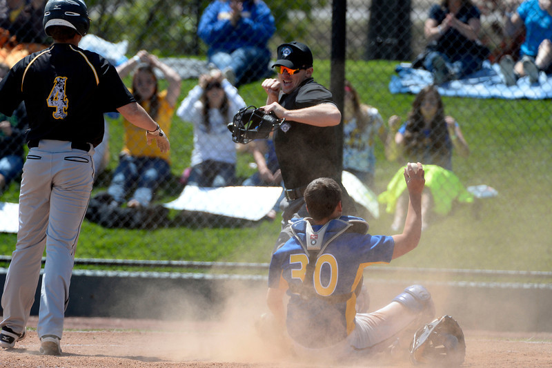 . Caliche Autin Zink (40) looks at umpire as he is tagged out by Dove Creek Alex Ogas (30) attempting to score in the Championship game May 15, 2014 at All-Star Park. Caliche defeated Dove Creek 17-1 for the title. (Photo by John Leyba/The Denver Post)