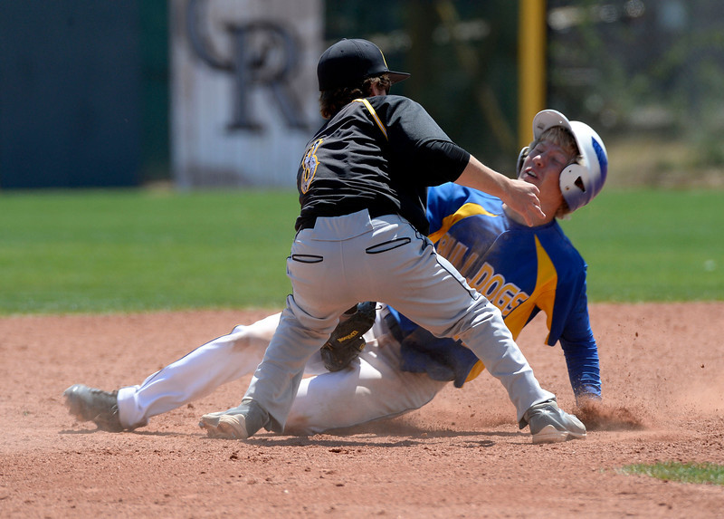 . Dove Creek Case Baughman (12) gets tagged out at second by Caliche Cade County (8) attempting to steal in the Championship game May 15, 2014 at All-Star Park. Caliche defeated Dove Creek 17-1 for the title. (Photo by John Leyba/The Denver Post)