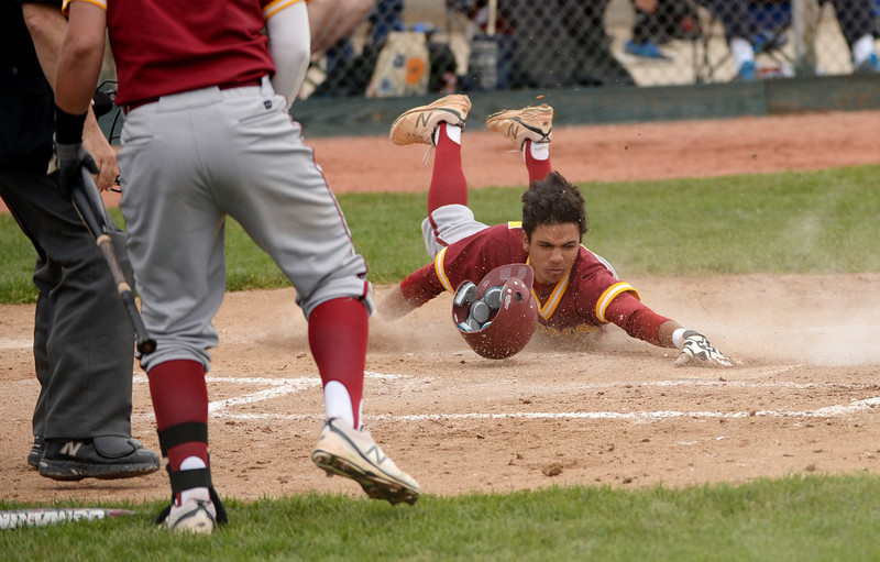 . Dean Lawson of Rocky Mountain High School (47) scores in the 3rd inning of the game against Regis Jesuit High School at All City Stadium. Denver, Colorado. May 24. 2014. Rocky Mountain High School won the 5A state championship game by 6-5. (Photo by Hyoung Chang/The Denver Post)