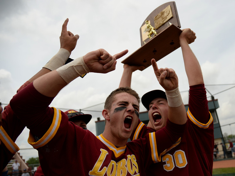 . Zachary Hahn (14), Carl Stajduhar (30) and Rocky Mountain High School baseball team celebrate winning of 5A state championship game against Regis Jesuit High School at All City Stadium. Denver, Colorado. May 24. 2014. Rocky Mountain High School won 6-5. (Photo by Hyoung Chang/The Denver Post)