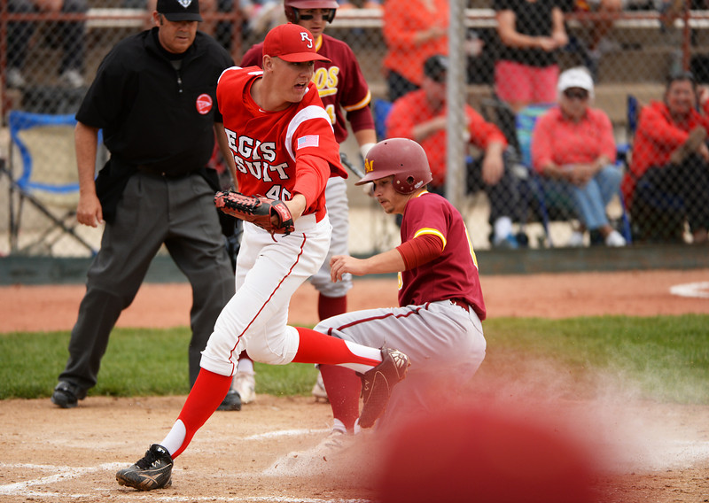 . Zachary Bartholomew of Rocky Mountain High School (8), right, scores in the 3rd inning of the game against Regis Jesuit High School at All City Stadium. Denver, Colorado. May 24. 2014. Rocky Mountain High School won the 5A state championship game by 6-5. (Photo by Hyoung Chang/The Denver Post)