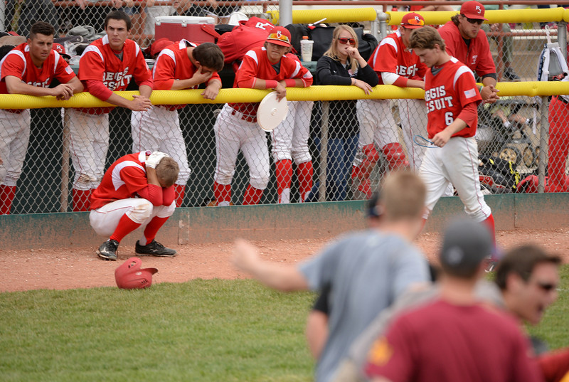 . Regis Jesuit High School baseball players react after losing 5A state championship game against Rocky Mountain High School at All City Stadium. Denver, Colorado. May 24. 2014. Rocky Mountain High School won 6-5. (Photo by Hyoung Chang/The Denver Post)