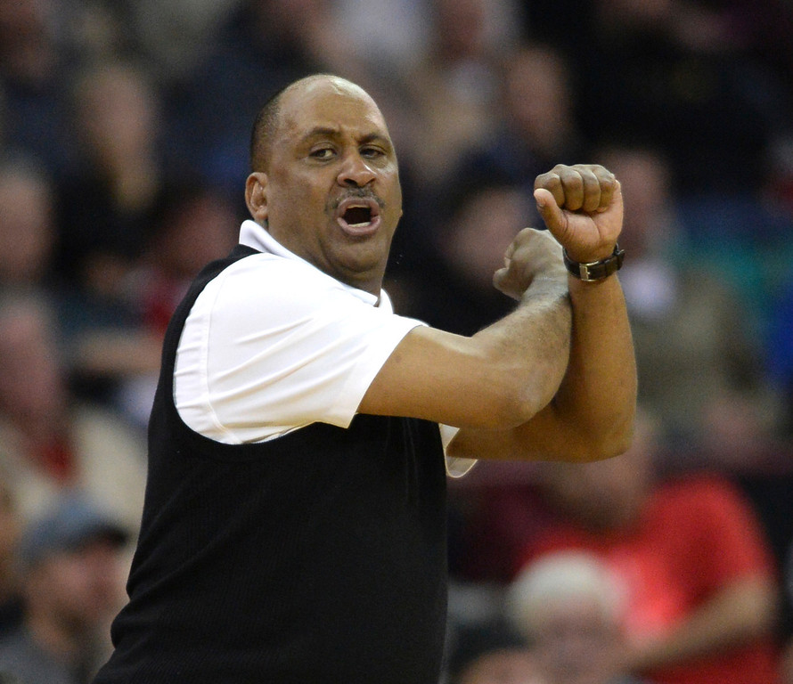 . DENVER, CO - MARCH 7: East coach Rudy Carey gestured to the team in the fourth quarter. The Denver East High School boy\'s basketball team defeated Highlands Ranch 64-44 in a 5A quarterfinal playoff game Friday night, March 7, 2014 in Denver, Colorado. (Photo by Karl Gehring/The Denver Post)