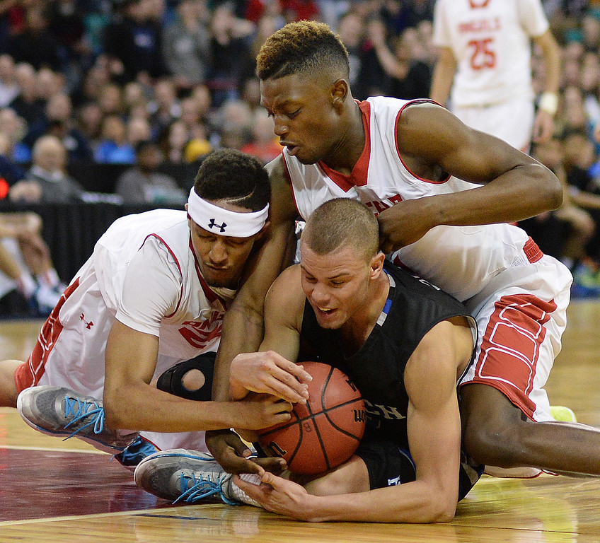 . DENVER, CO - MARCH 7: Dominique Collier, left, Jordan Willis, top, and Evan Motlong, bottom, all scrambled for a loose ball in the second half. The Denver East High School boy\'s basketball team defeated Highlands Ranch 64-44 in a 5A quarterfinal playoff game Friday night, March 7, 2014 in Denver, Colorado. (Photo by Karl Gehring/The Denver Post)
