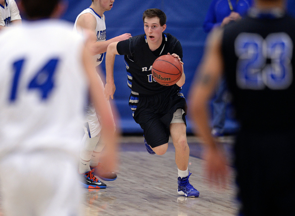 . PARKER, CO. - FEBRUARY 14, 2014: Highlands Ranch junior guard Ryley Stewart (13) dribbled through traffic in the second half. The Highlands Ranch High School boy\'s basketball team defeated Legend 60-46 Friday night February 14, 2104.  Photo By Karl Gehring/The Denver Post