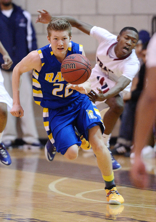 . Rams\' guard Thomas Fife (22) came up with a loose ball in the second half. The Rampart High School boy\'s basketball team defeated Cherokee Trail 67-64 Wednesday night, February 26, 2014. Photo By Karl Gehring/The Denver Post