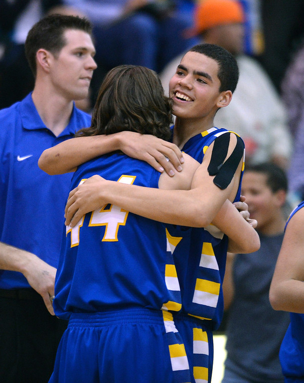 . The Rams celebrated the win Wednesday night. The Rampart High School boy\'s basketball team defeated Cherokee Trail 67-64 Wednesday night, February 26, 2014. Photo By Karl Gehring/The Denver Post