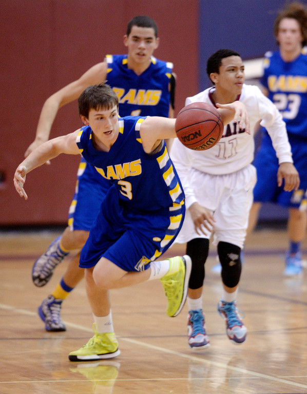 . Rampart senior guard Cameron hacker (3) took the ball away from Cherokee Trail freshman guard Jaizec Lottie (11) in the first half. The Cherokee Trail High School boy\'s basketball team hosted Rampart Wednesday night, February 26, 2014. Photo By Karl Gehring/The Denver Post
