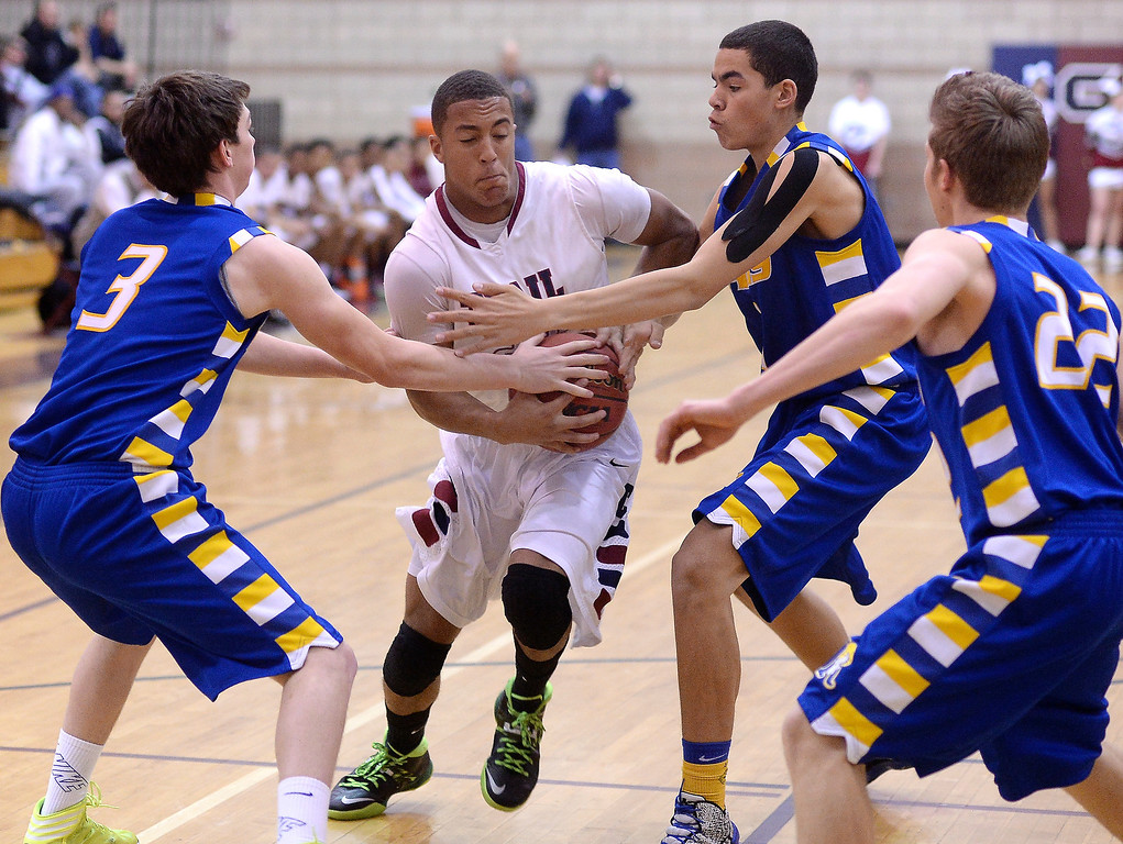 . Cherokee Trail senior forward Evan White (22) tried to push past Rampart defenders Cameron Hacker (3) and Tre Young (1) in the first half. The Cherokee Trail High School boy\'s basketball team hosted Rampart Wednesday night, February 26, 2014. Photo By Karl Gehring/The Denver Post