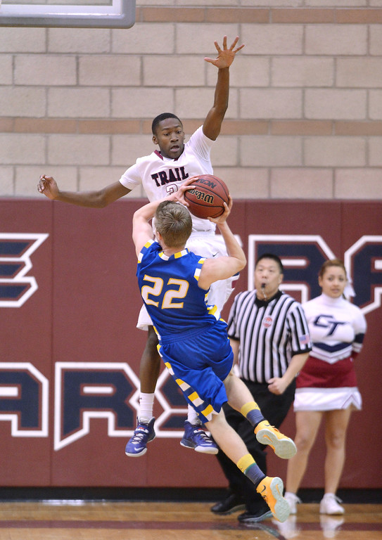 . Cherokee Trail defender Tyler Larkin (3) went up to block a shot by Rampart guard Thomas Fife (22) in the first half. The Rampart High School boy\'s basketball team defeated Cherokee Trail 67-64 Wednesday night, February 26, 2014. Photo By Karl Gehring/The Denver Post