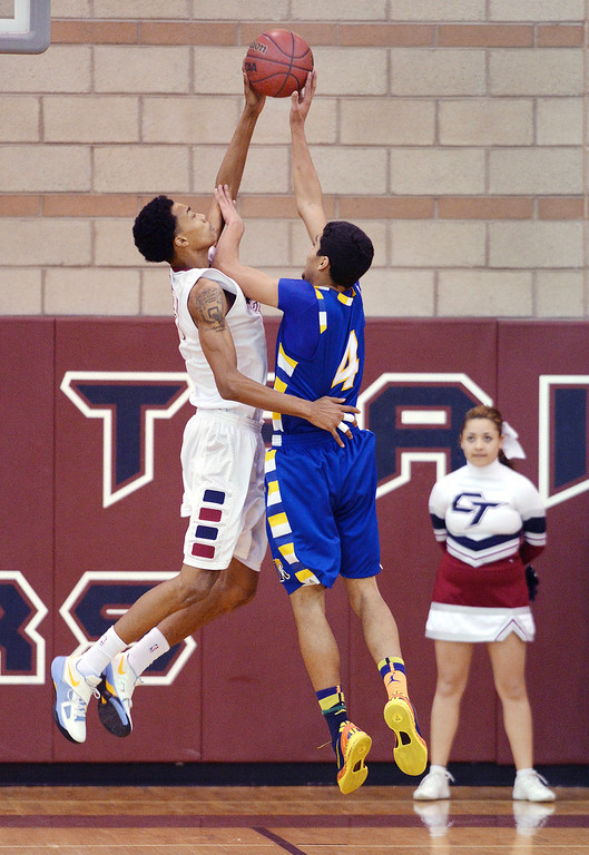. Cherokee Trail senior forward Robert Jones (23) rejected an attempt from Rampart junior forward Donovan Oldham (4) in the first half. The Rampart High School boy\'s basketball team defeated Cherokee Trail 67-64 Wednesday night, February 26, 2014. Photo By Karl Gehring/The Denver Post