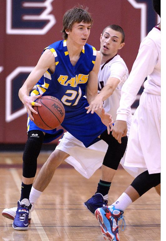. Cherokee Trial definer Dillon Garcia (4) guarded Rams\' junior forward Andy Churchill (21) in the first half. The Cherokee Trail High School boy\'s basketball team hosted Rampart Wednesday night, February 26, 2014. Photo By Karl Gehring/The Denver Post
