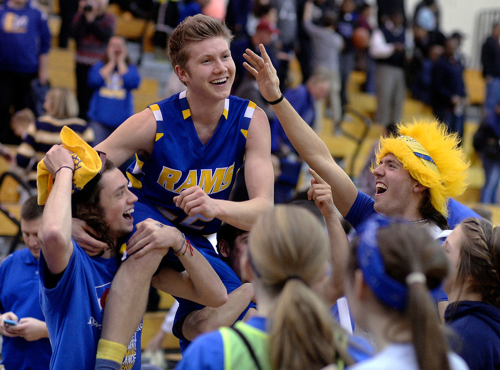 . Fans hoisted Rampart senior point guard Thomas Fife (22) onto their shoulders following the big win. The Rampart High School boy\'s basketball team defeated Cherokee Trail 67-64 Wednesday night, February 26, 2014. Photo By Karl Gehring/The Denver Post