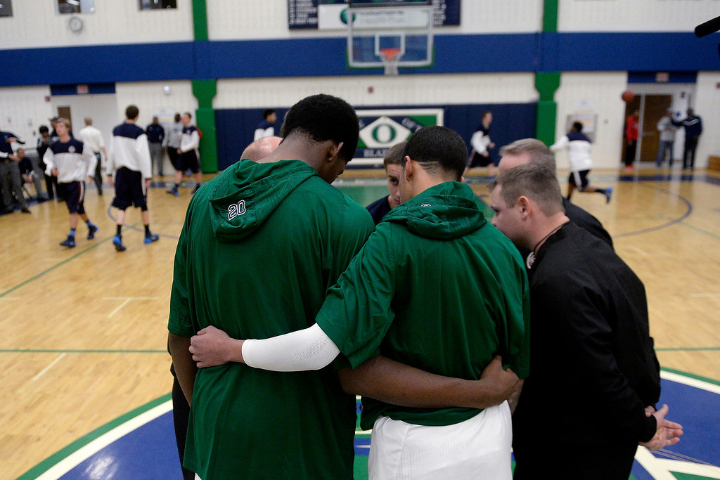 . T�Aren Williams (2) of the Overland Trailblazers and De�Ron Davis (20) wrap their arms around each other as they meet with the captains from the Dakota Ridge Eagles before the first half. (Photo By AAron Ontiveroz/The Denver Post)