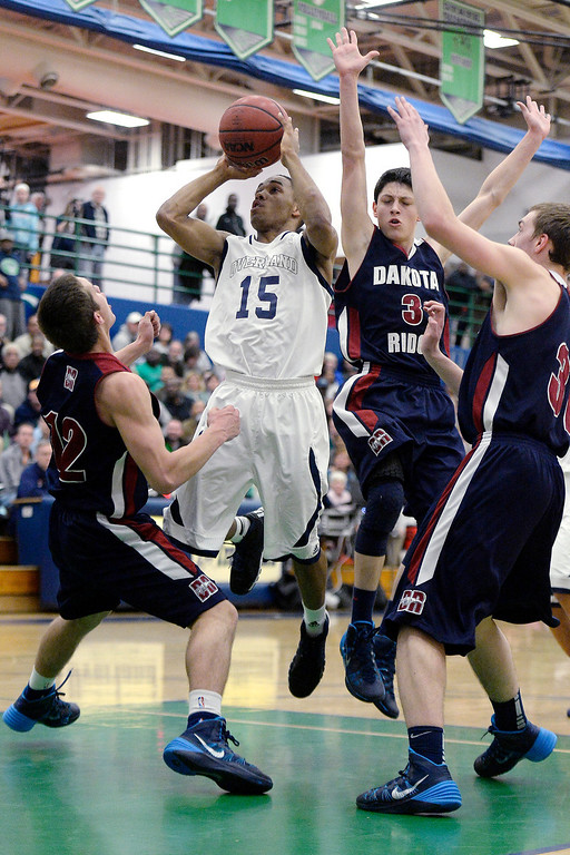 . Austin Conway (15) of the Overland Trailblazers converts a basket and draws a foul from Jake Flores (12) of the Dakota Ridge Eagles during the first half. (Photo By AAron Ontiveroz/The Denver Post)