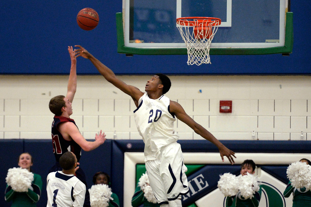 . De�Ron Davis (20) of the Overland Trailblazers contests a shot by Mason Grothuesmann (31) of the Dakota Ridge Eagles during the first half. (Photo By AAron Ontiveroz/The Denver Post)