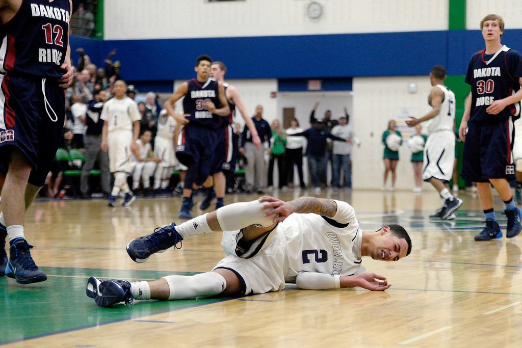. T�Aren Williams (2) of the Overland Trailblazers holds his knee after taking contact against the Dakota Ridge Eagles during the first half. (Photo By AAron Ontiveroz/The Denver Post)