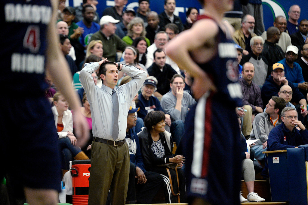 . Head coach Curi Yutzy of the Dakota Ridge Eagles reacts to his team\'s play against the Overland Trailblazers during the first half. (Photo By AAron Ontiveroz/The Denver Post)
