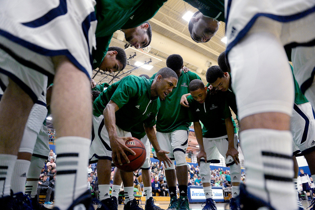 . Austin Conway (15) of the Overland Trailblazers hypes his teammates before the first half. (Photo By AAron Ontiveroz/The Denver Post)