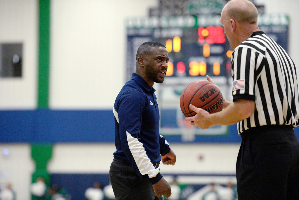 . head coach Danny Fisher of the Overland Trailblazers speaks sternly with a referee after his player, T�Aren Williams (2), took contact against the Dakota Ridge Eagles during the first half. (Photo By AAron Ontiveroz/The Denver Post)