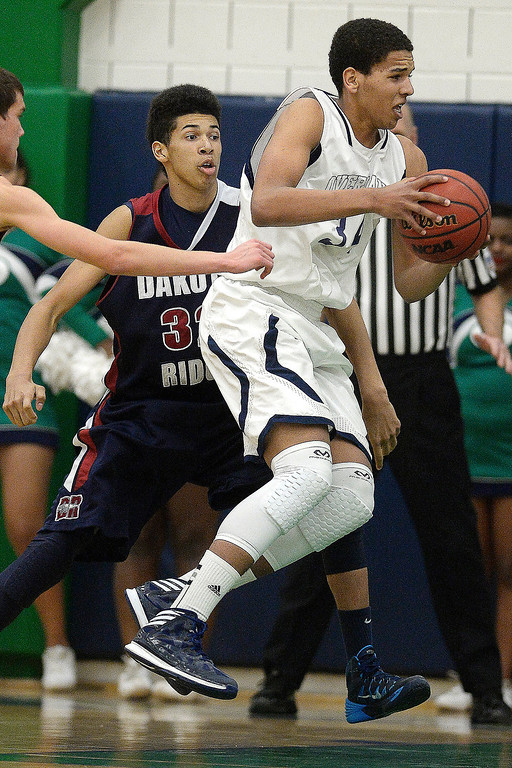 . Ryan Swan (34) of the Overland Trailblazers drives against the Dakota Ridge Eagles during the second half. (Photo By AAron Ontiveroz/The Denver Post)
