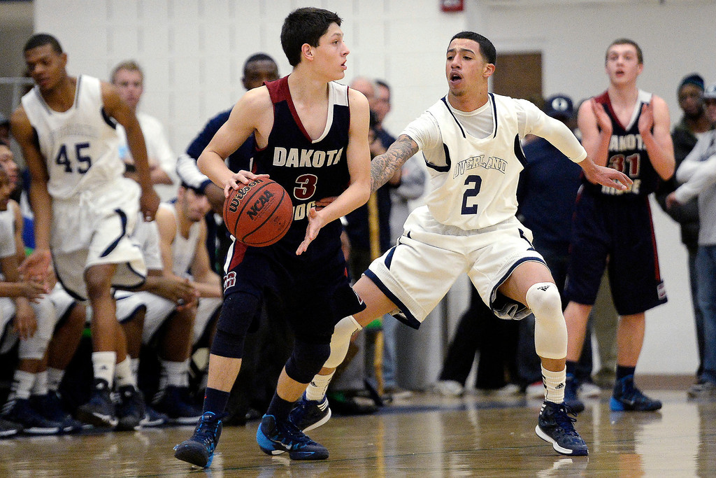 . T�Aren Williams (2) of the Overland Trailblazers covers Cambrian Antrillo (3) of the Dakota Ridge Eagles during the first half. (Photo By AAron Ontiveroz/The Denver Post)
