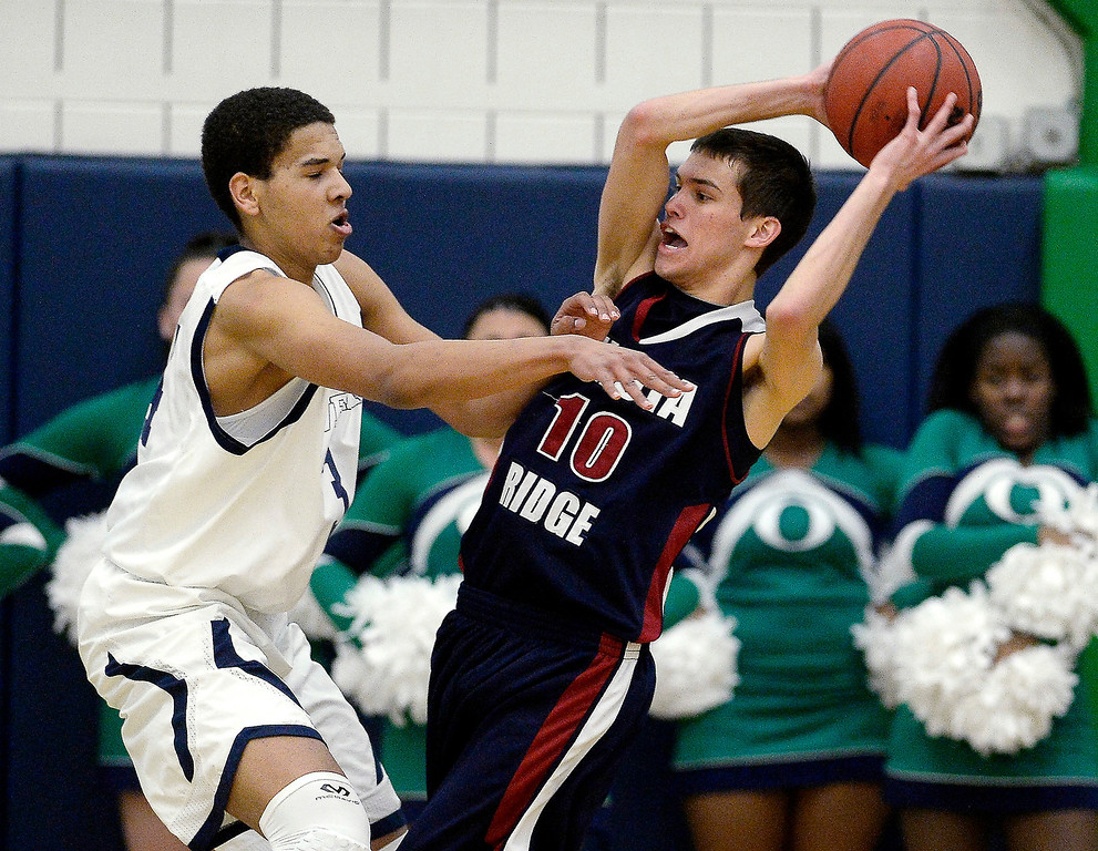 . Ryan Swan (34) of the Overland Trailblazers plays physical defense on Cody Pittman (10) of the Dakota Ridge Eagles during the first half of 5A playoff basketball action. (Photo By AAron Ontiveroz/The Denver Post)