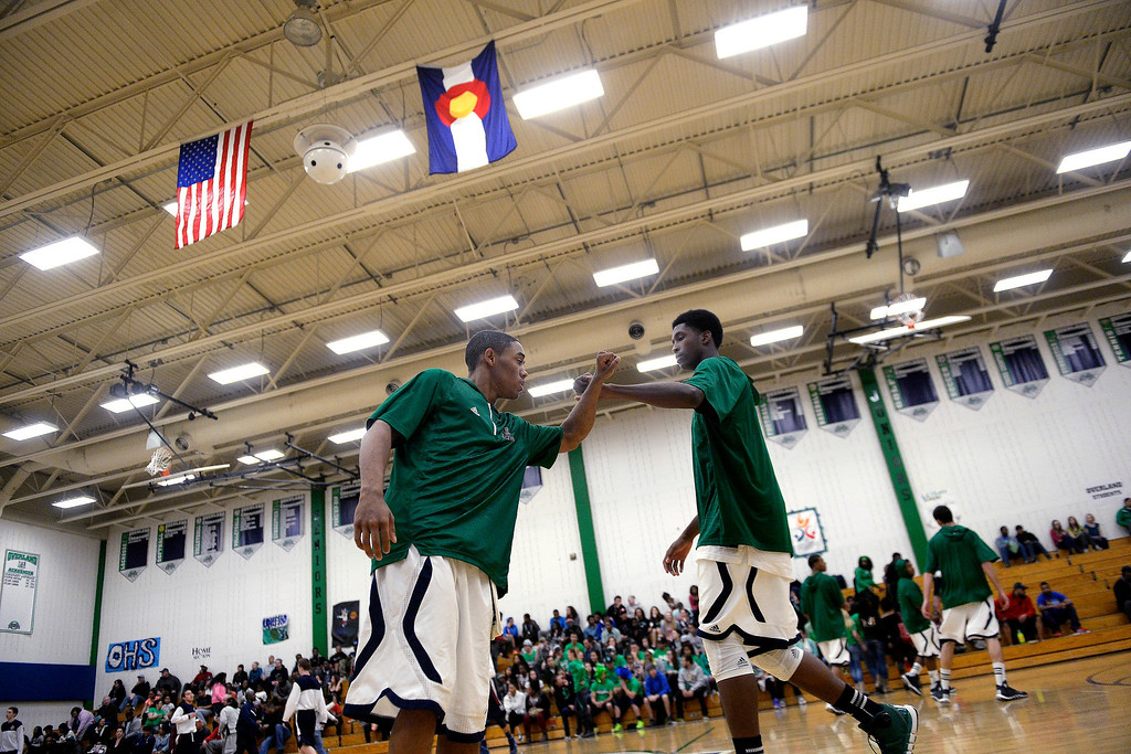 . Austin Conway (15) of the Overland Trailblazers and De�Ron Davis (20) bump fists before the first half. (Photo By AAron Ontiveroz/The Denver Post)